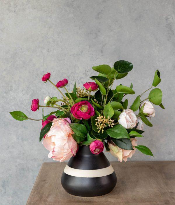 Faux peach peony and fuchsia ranunculus floral arrangement
