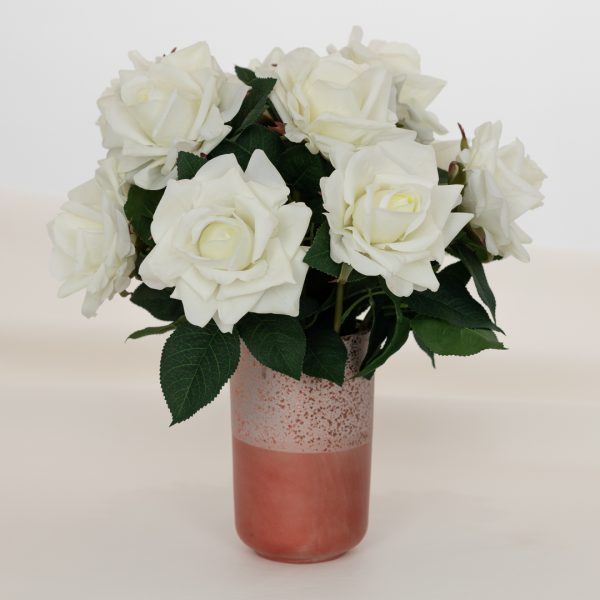 One dozen real touch artificial white roses in pink vase on soft background